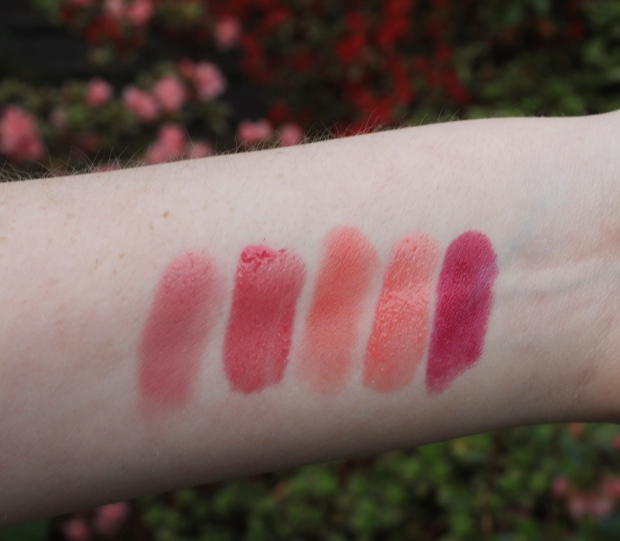 From L to R - Maybelline Color Whisper in Lust For Blush, Maybelline Color Sensational Lip Gloss in One Shine Day, Revlon Super Lustrous Lipstick in Lovers Coral, Maybelline Color Sensational Shine Gloss in Glorious Grapefruit, Revlon Lip Butter in Raspberry Pie